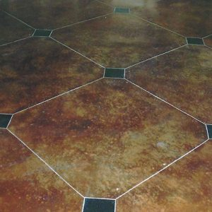 stained concrete floor with diamond etching accent
