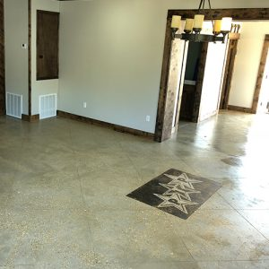 stained concrete floor with company logo stamp