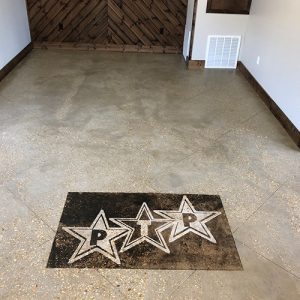 stained concrete floor with company logo