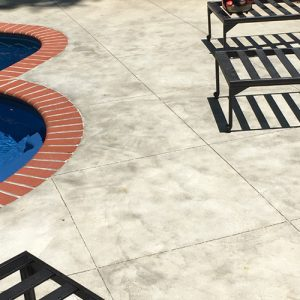 stained concrete pool deck with diamond etching accent