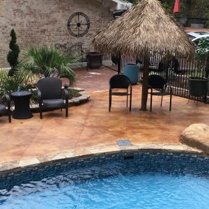 stained concrete by pool deck